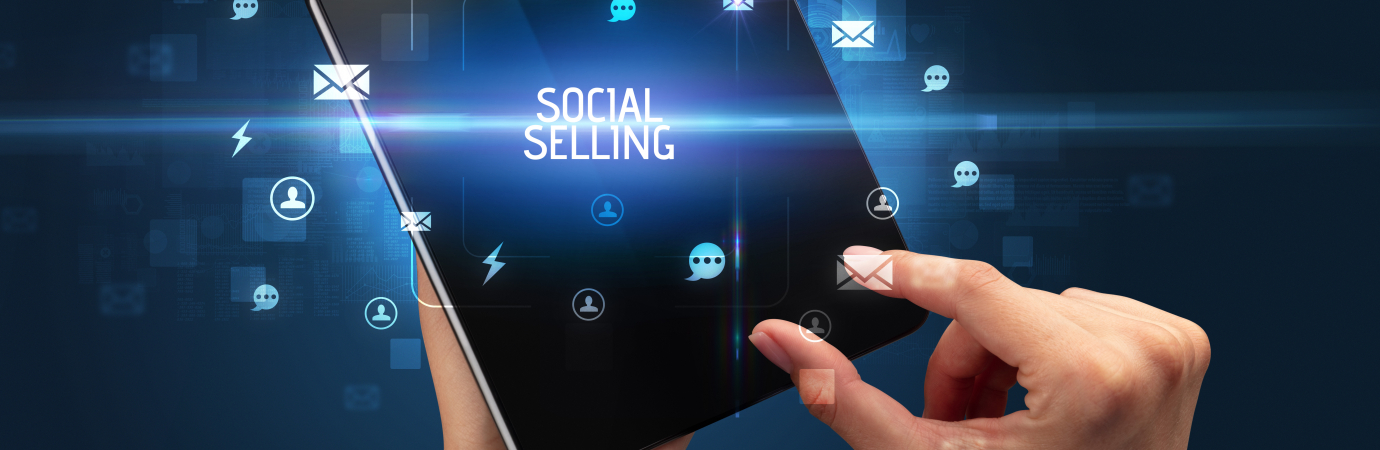 Businessman holding a foldable smartphone with SOCIAL SELLING inscription, social networking concept